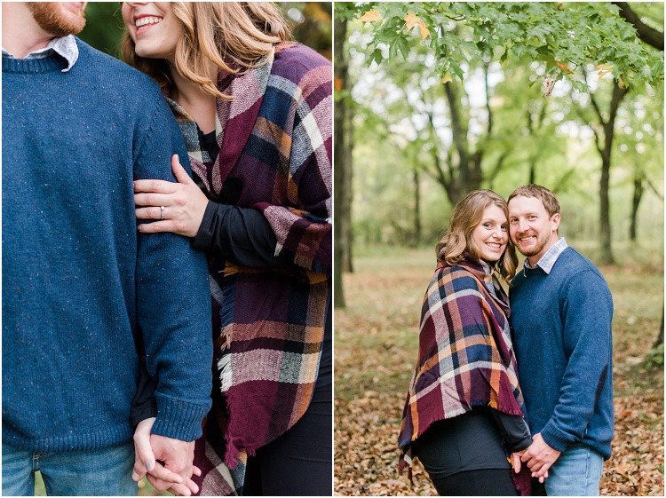 engaged-couple-smile-at-camera-in-woods-at-high-cliff-engagement-session-by-milwaukee-wedding-photographer-kyra-rane-photography