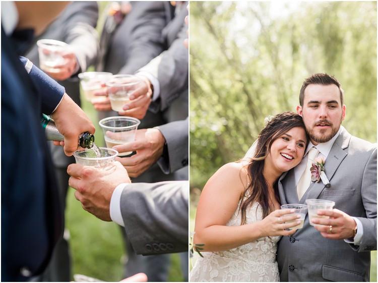 wedding-party-toasts-at-de-pere-wisconsin-wedding-by-appleton-wedding-photographer-kyra-rane-photography