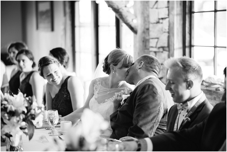wedding-couple-kiss-at-table-at-olde-41-wedding-by-appleton-wedding-photographer-kyra-rane-photography
