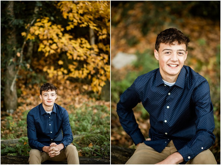 boy-sitting-on-log-looking-at-camera-at-senior-session-at-high-cliff-state-park-by-green-bay-wedding-photographer-kyra-rane-photography