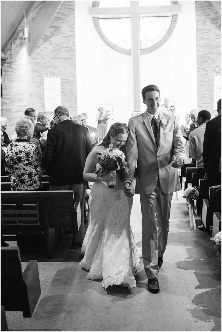 bride-and-groom-walking-down-aisle-at-minnesota-wedding-by-green-bay-wedding-photographer-kyra-rane-photography