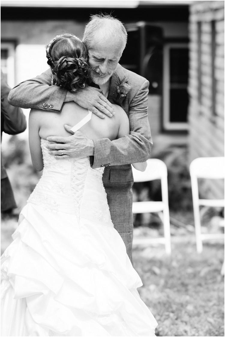 father-giving-bride-away-at-wisconsin-farm-wedding-by-green-bay-wedding-photographer-kyra-rane-photography