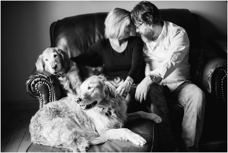 husband-and-wife-with-two-golden-retrievers-on-couch-at-in-home-anniversary-session-by-appleton-wedding-photographer-kyra-rane-photography