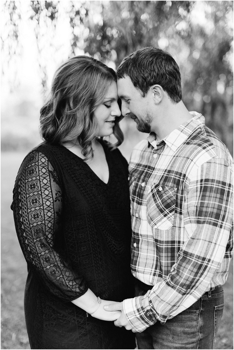 engaged-couple-hold-hands-under-willow-tree-at-high-cliff-engagement-session-by-milwaukee-wedding-photographer-kyra-rane-photography