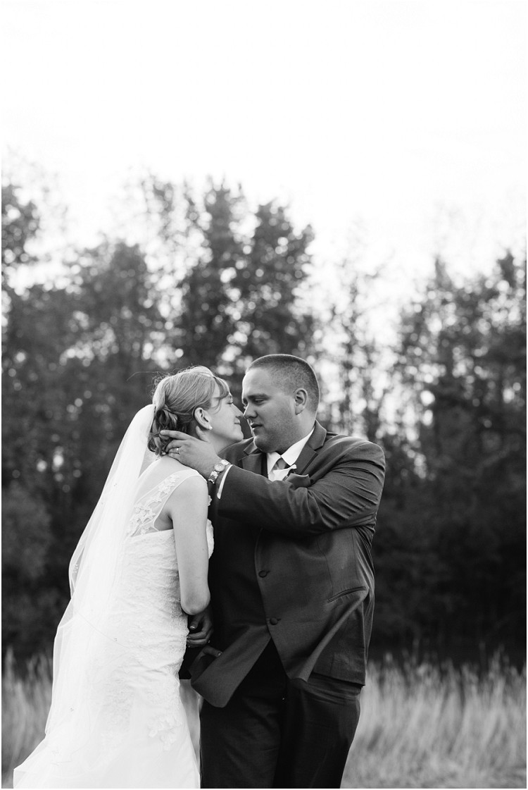 wedding-couple-about-to-kiss-in-field-at-olde-41-wedding-by-green-bay-wedding-photographer-kyra-rane-photography