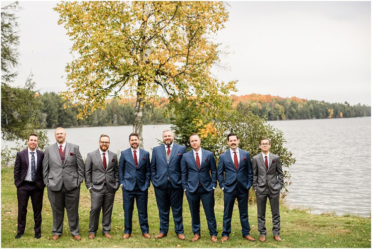 groomsmen-looking-at-camera-at-northern-wisconsin-autumn-wedding-by-green-bay-wedding-photographer-kyra-rane-photography