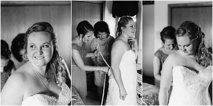 bride-mom-and-moh-getting-into-wedding-dress-at-minnesota-wedding-by-green-bay-wedding-photographer-kyra-rane-photography
