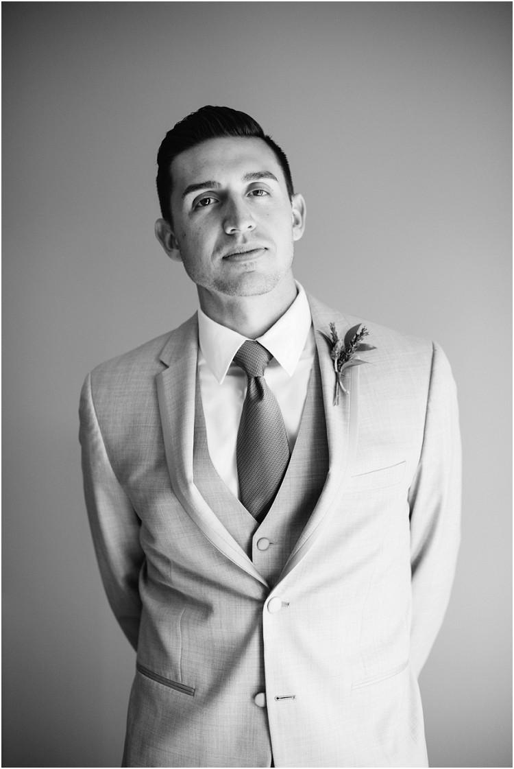 groom-portrait-at-best-western-premier-waterfront-hotel-wedding-by-appleton-wedding-photographer-kyra-rane-photography
