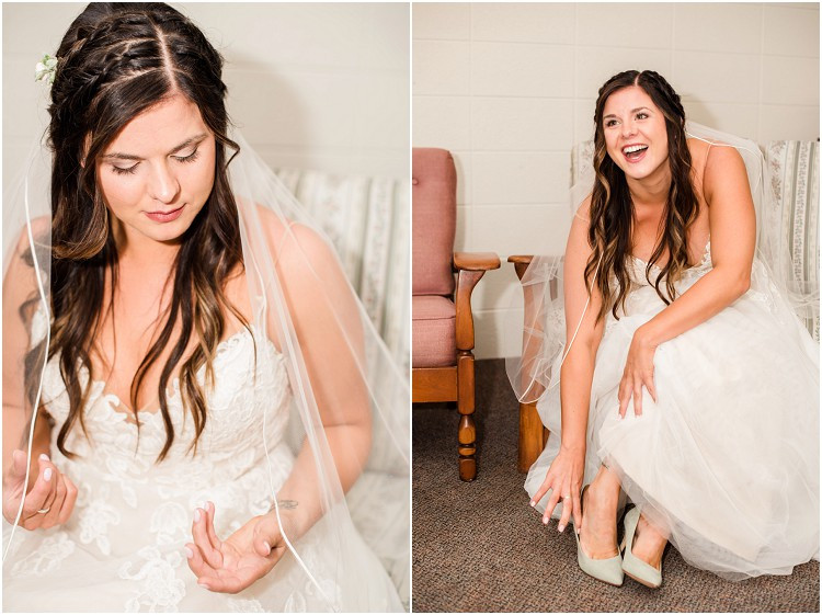 bride-in-white-lace-wedding-dress-putting-on-heels-at-de-pere-wisconsin-wedding-by-green-bay-wedding-photographer-kyra-rane-photography