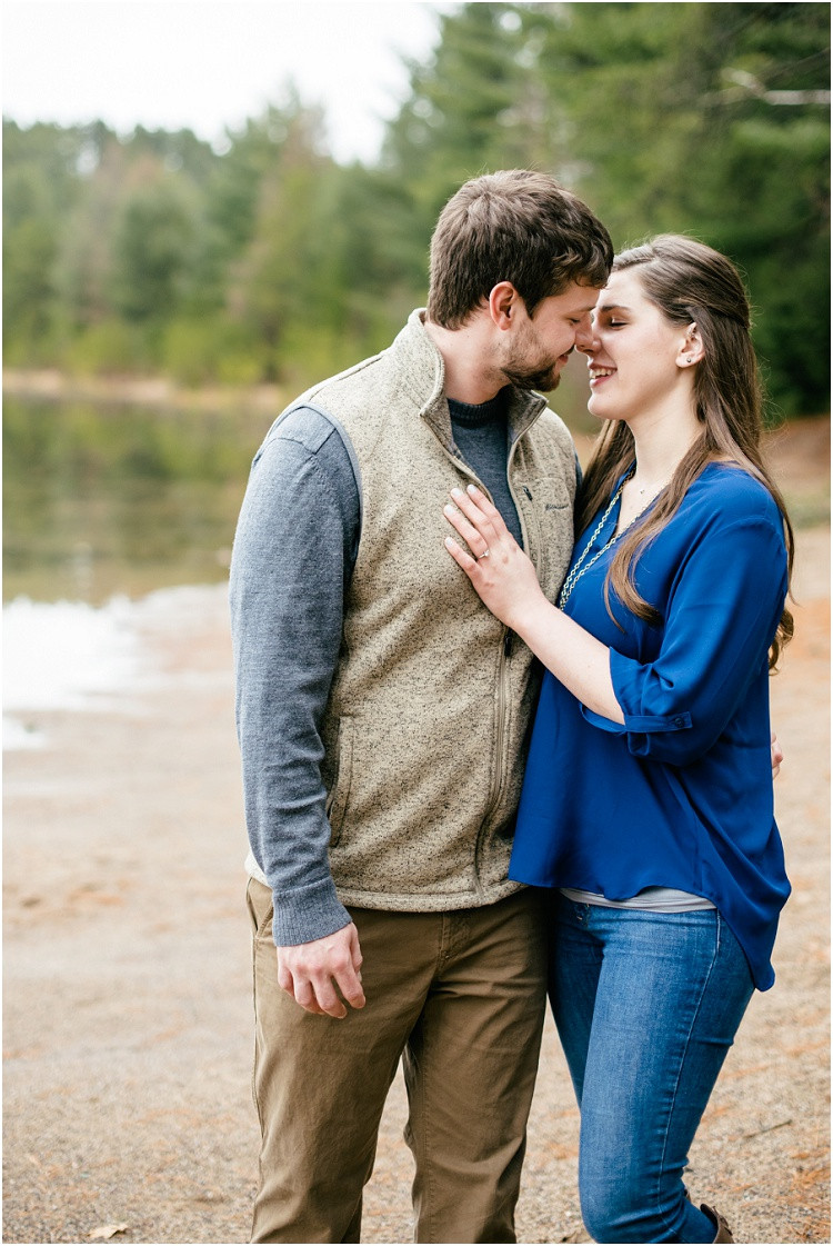 engaged-couple-about-to-kiss-at-northwoods-lakeside-engagement-session-by-green-bay-wedding-photographer-kyra-rane-photography