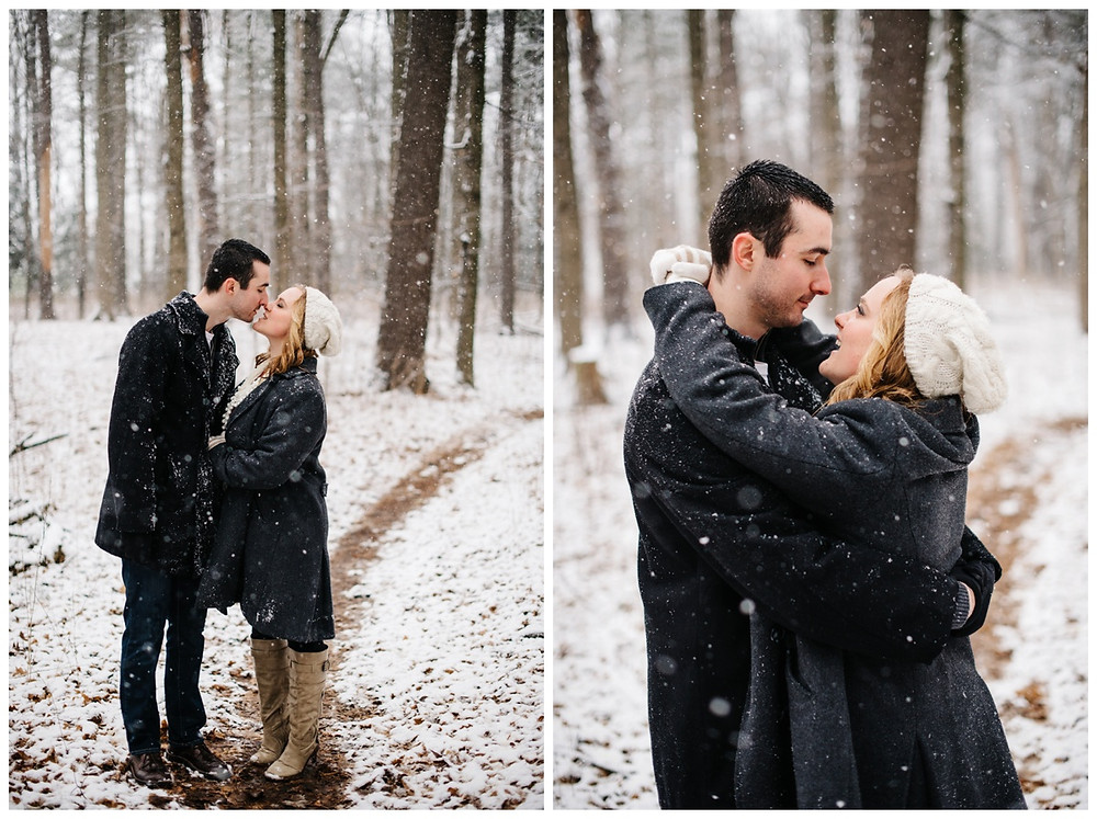 engaged-couple-about-to-kiss-walking-on-trail-at-snowy-sheboygan-engagement-session-by-milwaukee-wedding-photographer-kyra-rane-photography