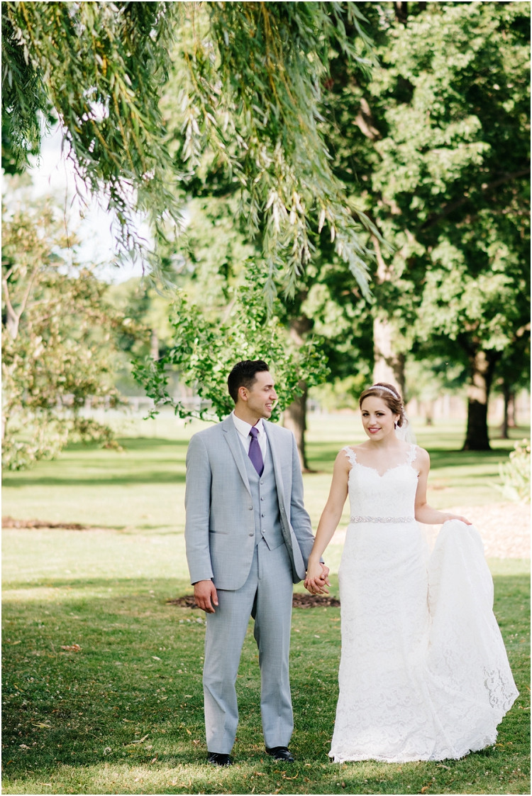 bride-holding-dress-at-best-western-premier-waterfront-hotel-wedding-by-appleton-wedding-photographer-kyra-rane-photography