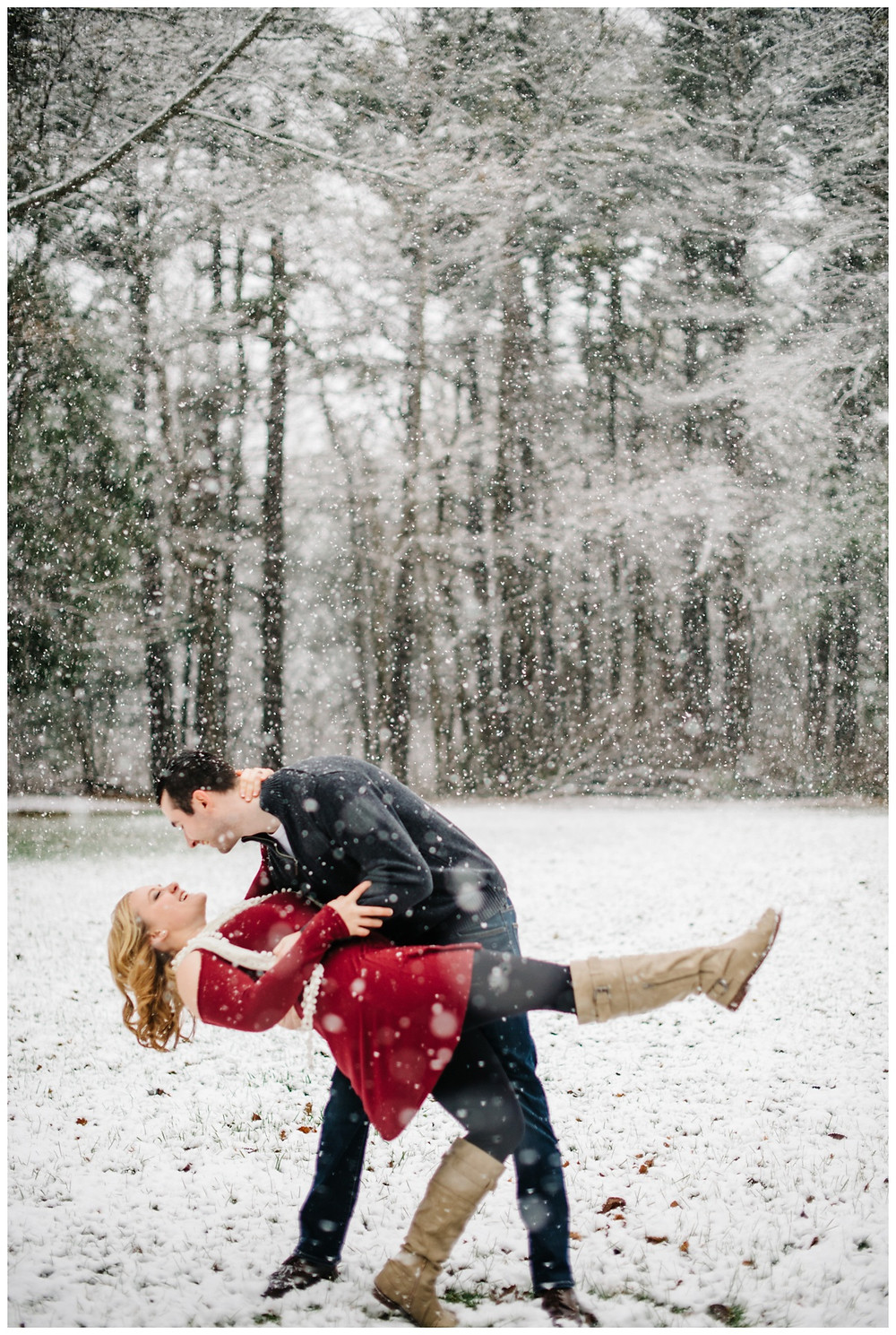 engaged-couple-dipping-at-snowy-sheboygan-engagement-session-by-green-bay-wedding-photographer-kyra-rane-photography