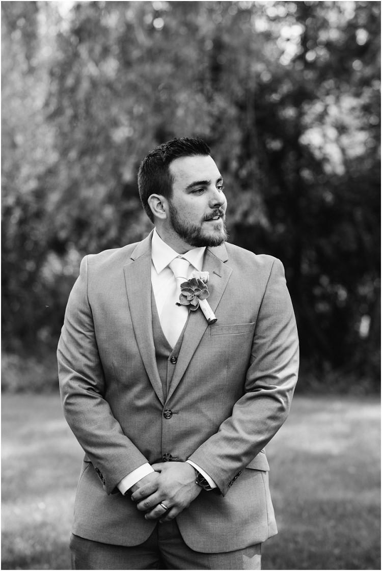 groom-smiling-at-de-pere-wisconsin-wedding-by-green-bay-wedding-photographer-kyra-rane-photography