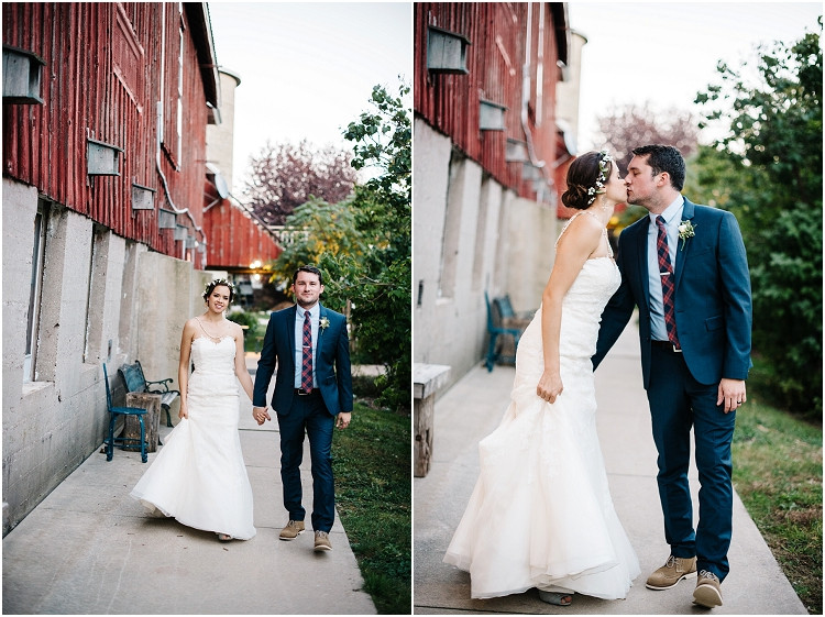 wedding-couple-kissing-by-barn-at-barnsite-retreat-and-events-wedding-by-green-bay-wedding-photographer-kyra-rane-photography