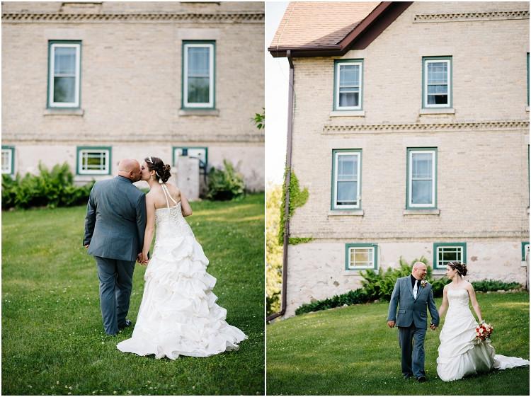 wedding-couple-walking-holding-hands-at-wisconsin-farm-wedding-by-appleton-wedding-photographer-kyra-rane-photography