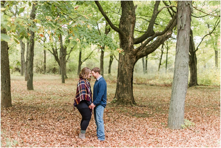 engaged-couple-hold-hands-in-woods-at-high-cliff-engagement-session-by-green-bay-wedding-photographer-kyra-rane-photography