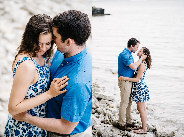 engaged-couple-nuzzled-close-by-lake-at-cave-point-engagement-session-by-appleton-wedding-photographer-kyra-rane-photography