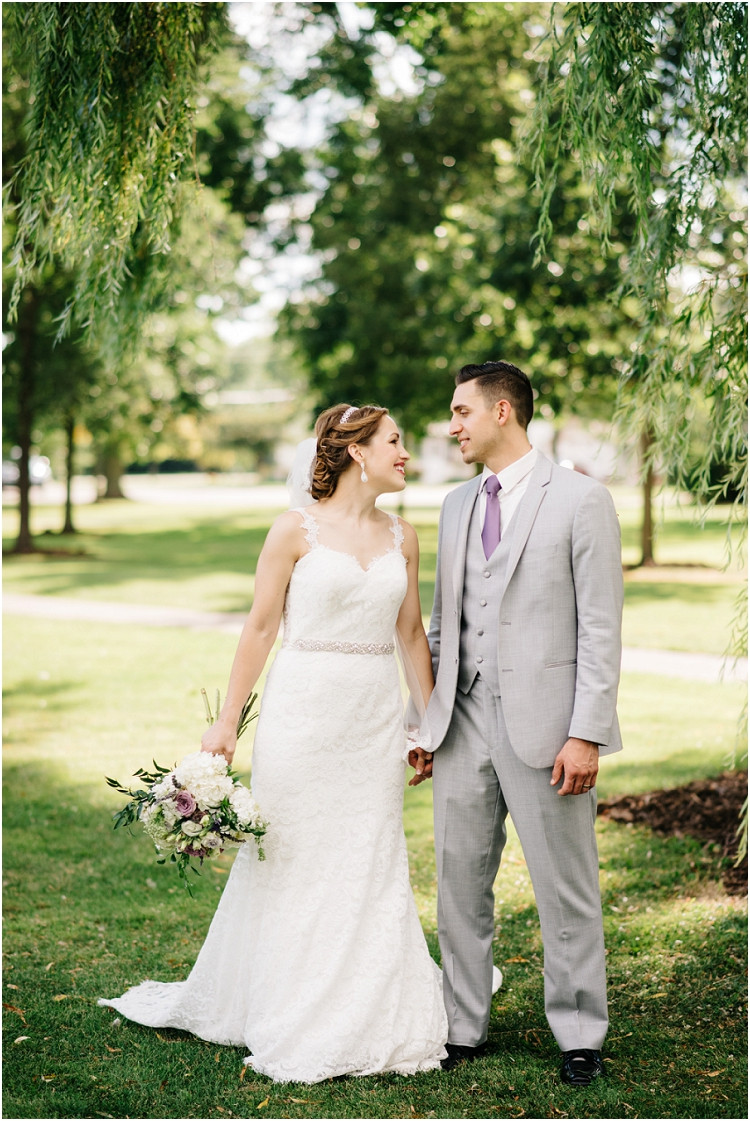 wedding-couple-smiling-at-each-other-at-best-western-premier-waterfront-hotel-wedding-by-appleton-wedding-photographer-kyra-rane-photography