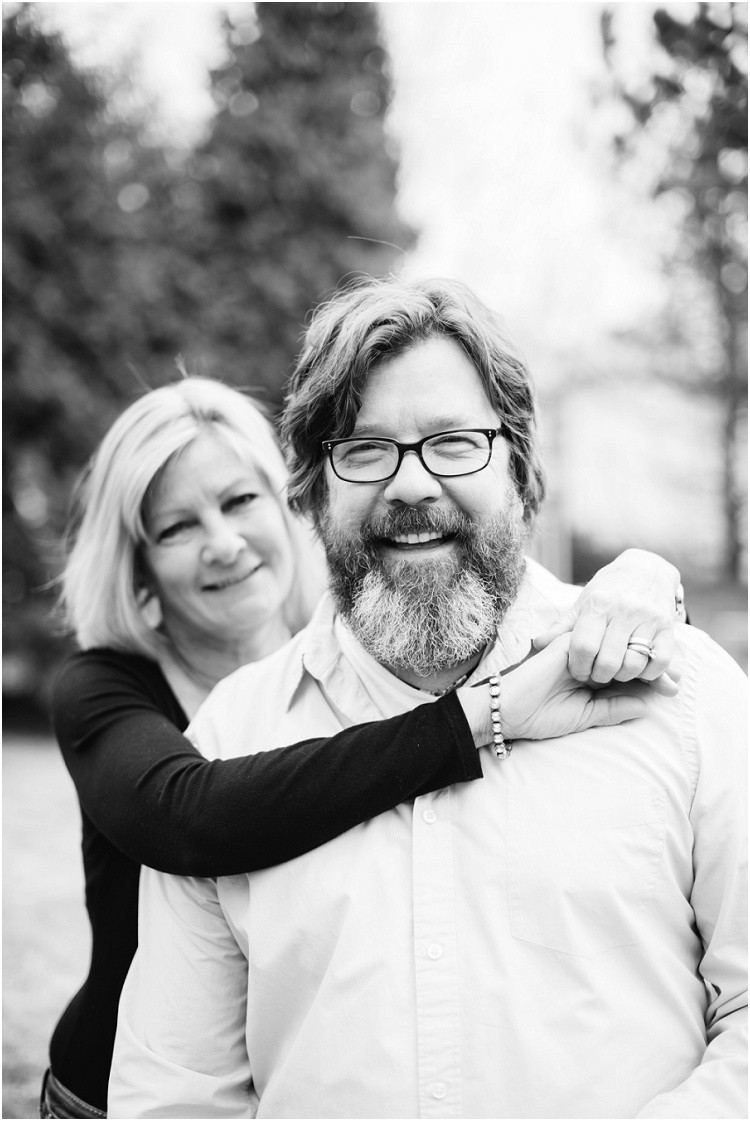 husband-and-wife-smiling-at-camera-at-in-home-anniversary-session-by-appleton-wedding-photographer-kyra-rane-photography