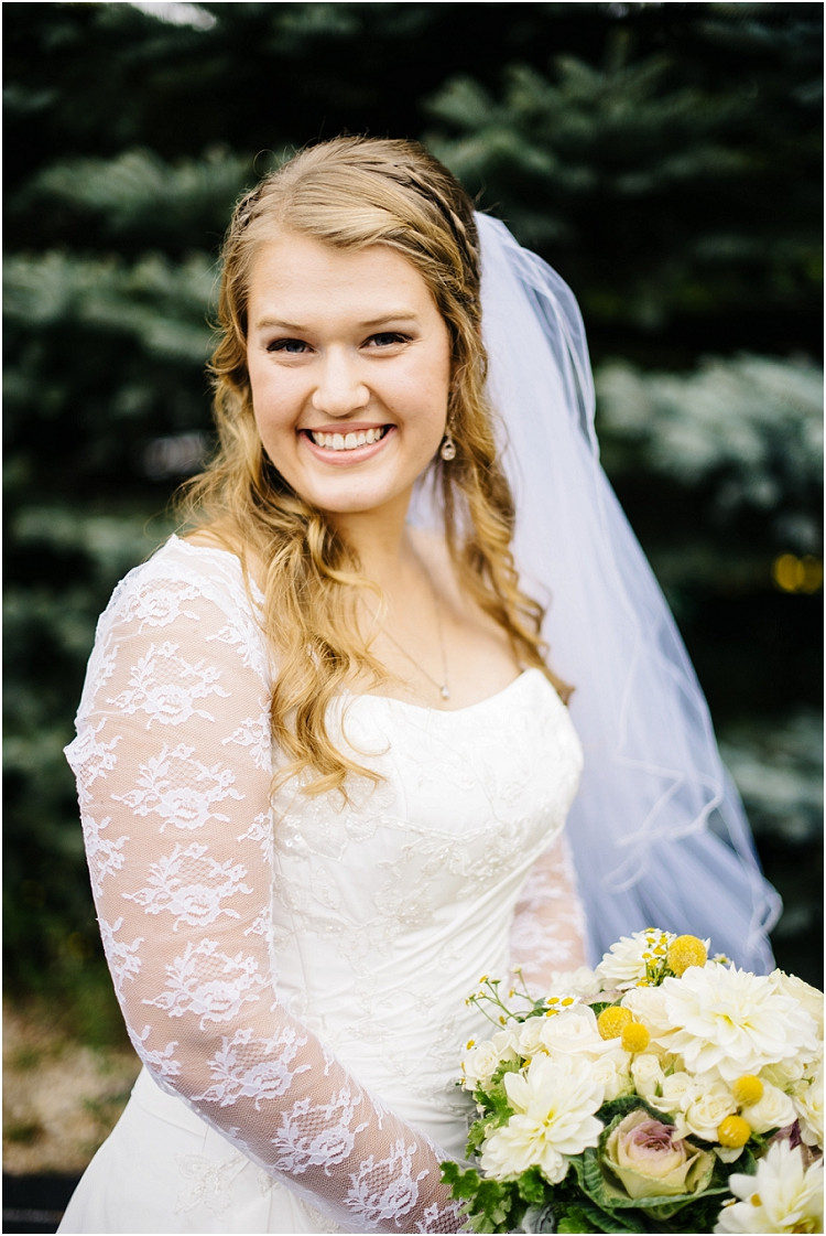 bride-smiling-at-camera-with-bouquet-at-pamperin-park-wedding-by-appleton-wedding-photographer-kyra-rane-photography