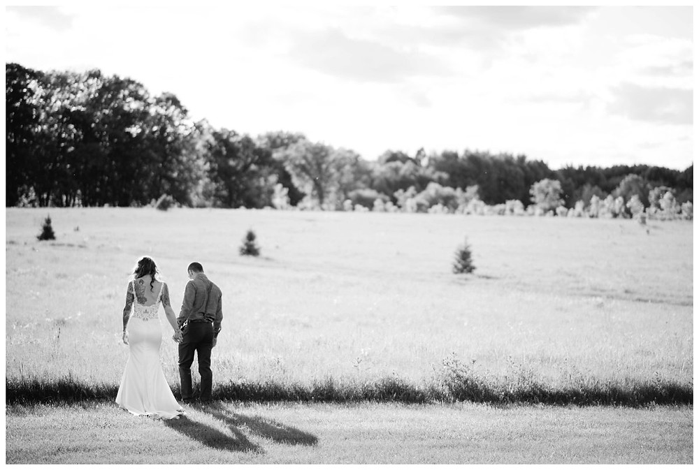wedding-couple-walking-in-field-at-homestead-meadows-styled-shoot-by-appleton-wedding-photographer-kyra-rane-photography