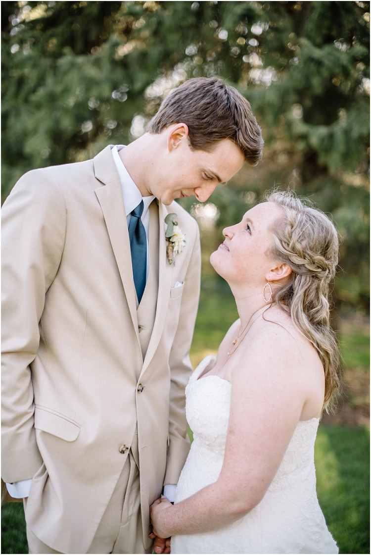 wedding-couple-smiling-at-each-other-at-minnesota-wedding-by-green-bay-wedding-photographer-kyra-rane-photography