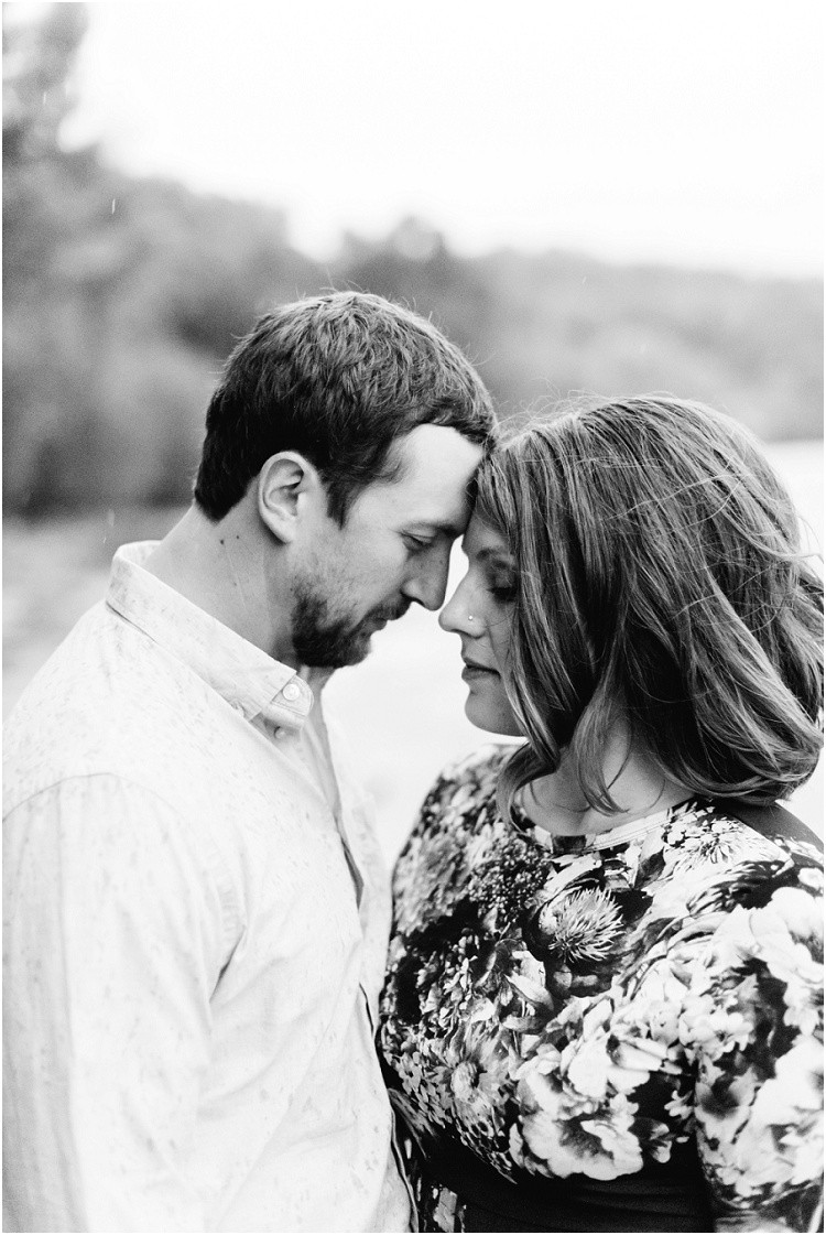 engaged-couple-foreheads-together-under-rain-at-high-cliff-engagement-session-by-green-bay-wedding-photographer-kyra-rane-photography