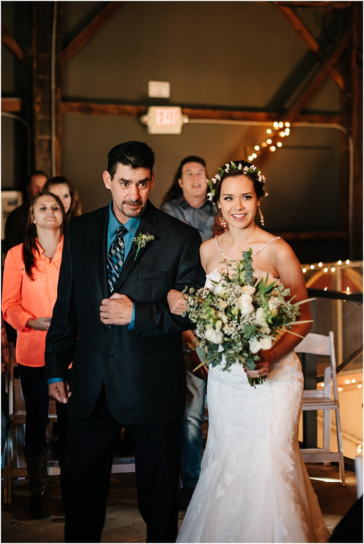 bride-walking-down-the-aisle-at-barnsite-retreat-and-events-wedding-by-milwaukee-wedding-photographer-kyra-rane-photography