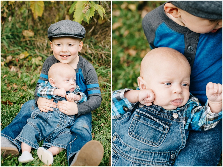 brothers-sitting-by-leaves-at-fall-mini-session-favorites-by-appleton-wedding-photographer-kyra-rane-photography