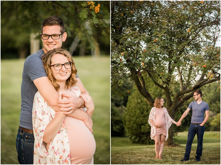 expecting-couple-holding-hands-under-tree-at-plamann-park-maternity-session-by-green-bay-wedding-photographer-kyra-rane-photography