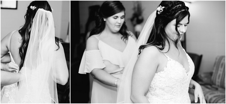 zipping-up-bride-in-wedding-dress-at-de-pere-wisconsin-wedding-by-appleton-wedding-photographer-kyra-rane-photography