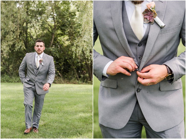 groom-buttoning-up-jacket-at-de-pere-wisconsin-wedding-by-appleton-wedding-photographer-kyra-rane-photography