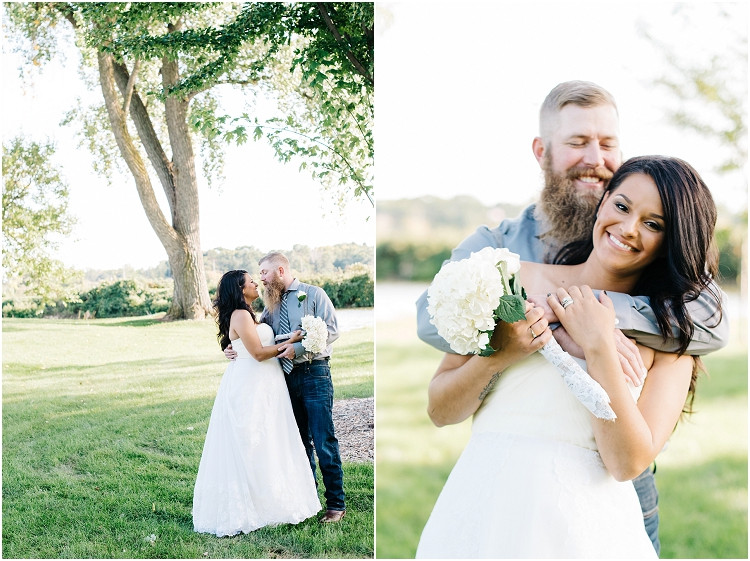 bride-and-groom-holding-each-other-at-little-chute-waterfront-wedding-by-green-bay-wedding-photographer-kyra-rane-photography
