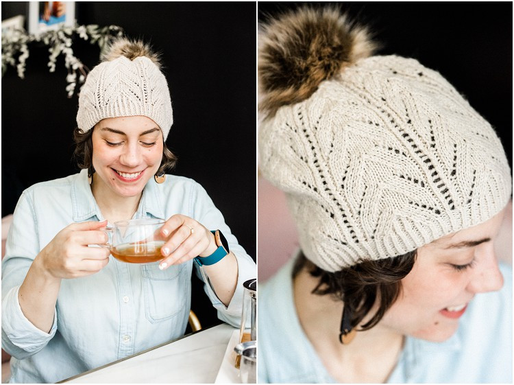 sipping-tea-with-white-knitted-hat-at-fika-tea-bar-by-green-bay-wedding-photographer-kyra-rane-photography