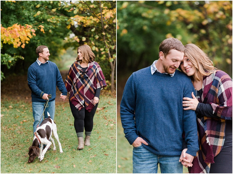 engaged-couple-walk-on-trail-with-dog-at-high-cliff-engagement-session-by-milwaukee-wedding-photographer-kyra-rane-photography