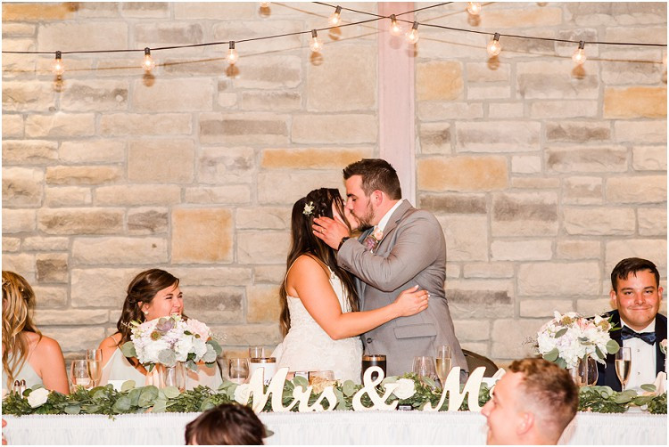 bride-and-groom-reception-first-kiss-at-de-pere-wisconsin-wedding-by-green-bay-wedding-photographer-kyra-rane-photography