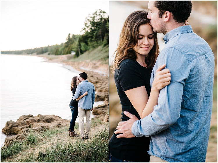 engaged-couple-walking-along-beach-trail-at-cave-point-engagement-session-by-green-bay-wedding-photographer-kyra-rane-photography