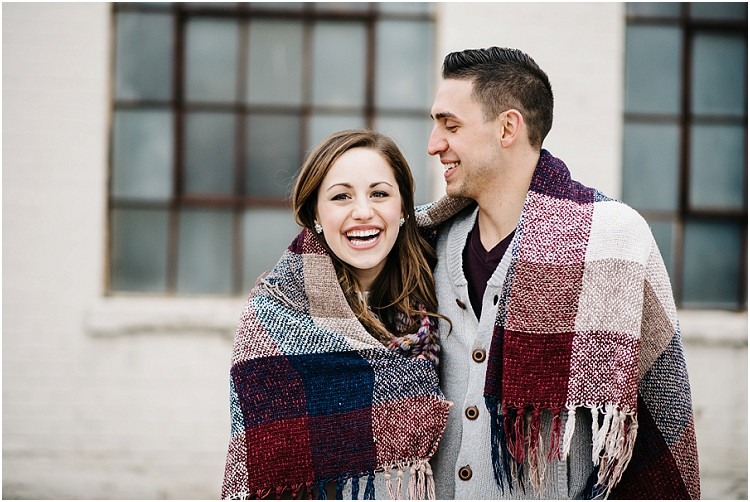 couple-laughing-under-blanket-at-appleton-engagement-session-by-green-bay-wedding-photographer-kyra-rane-photography