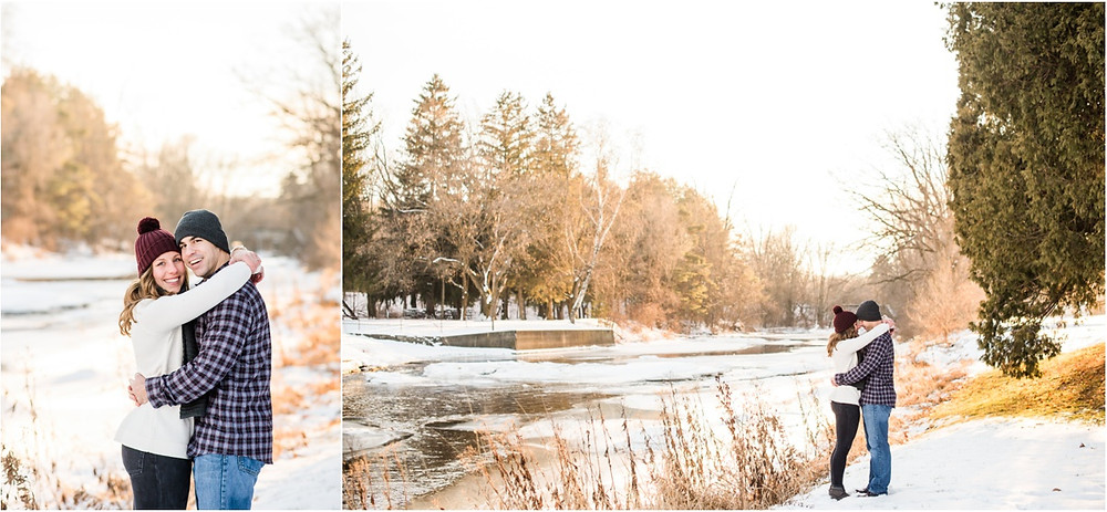 engaged-couple-cuddled-beside-river-at-pamperin-park-winter-engagement-session-by-appleton-wedding-photographer-kyra-rane-photography