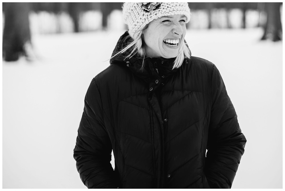 woman-smiling-in-crochet-hat-at-winter-portrait-session-at-pierce-park-by-appleton-wedding-photographer-kyra-rane-photography