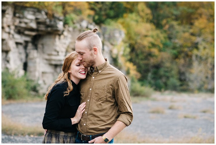 husband-and-wife-nuzzling-close-at-anniversary-session-at-high-cliff-state-park-by-green-bay-wedding-photographer-kyra-rane-photography