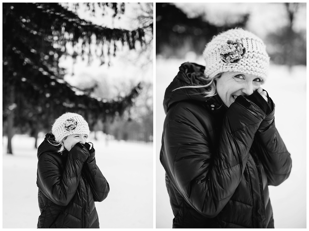 woman-warming-up-hands-at-winter-portrait-session-at-pierce-park-by-appleton-wedding-photographer-kyra-rane-photography