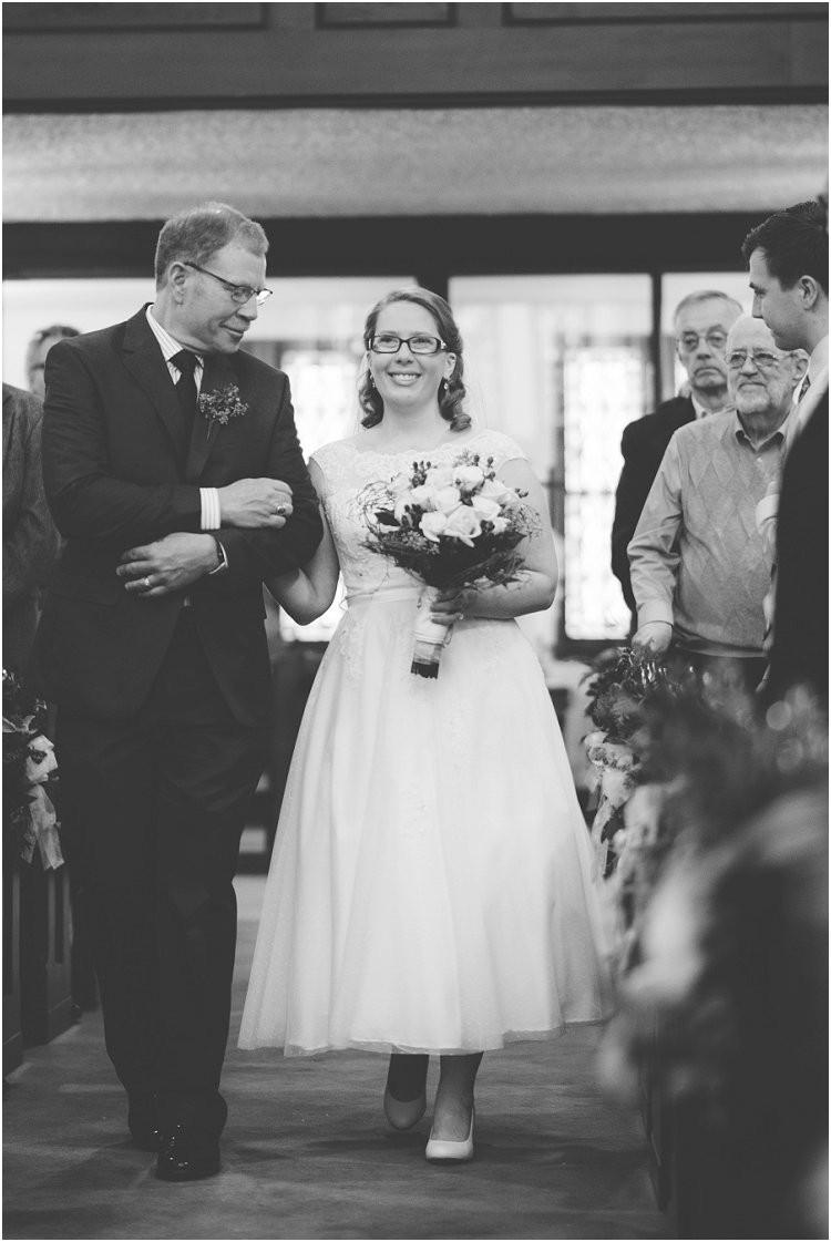 bride-walking-down-the-aisle-at-sheboygan-winter-wedding-by-green-bay-wedding-photographer-kyra-rane-photography