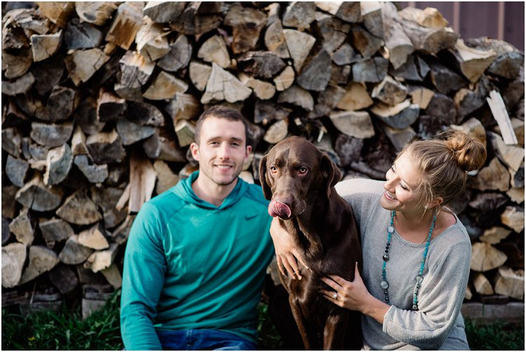engaged-couple-laughing-with-dog-at-hortonville-engagement-session-by-green-bay-wedding-photographer-kyra-rane-photography