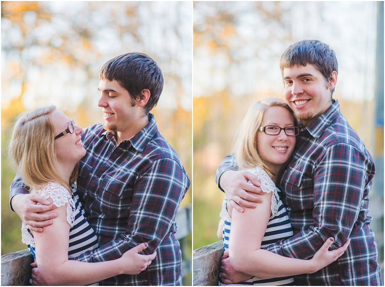 couple-holding-each-other-and-smiling-at-maywood-environmental-park-engagement-session-by-appleton-wedding-photography-kyra-rane-photography