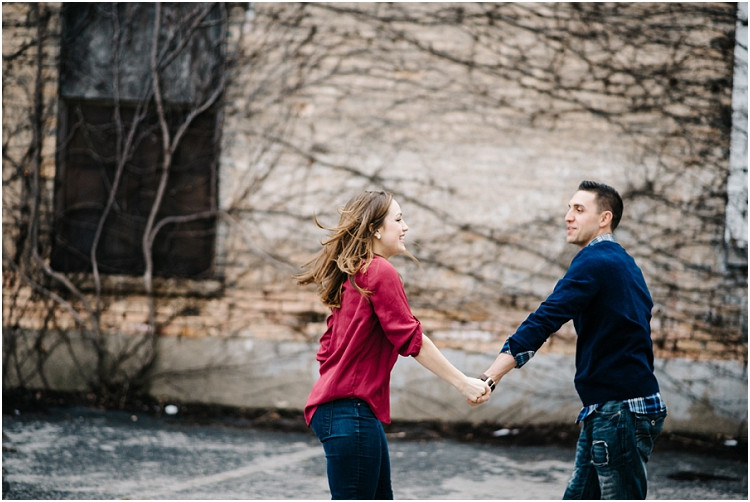 couple-dancing-in-alley-at-appleton-engagement-session-by-appleton-wedding-photographer-kyra-rane-photography