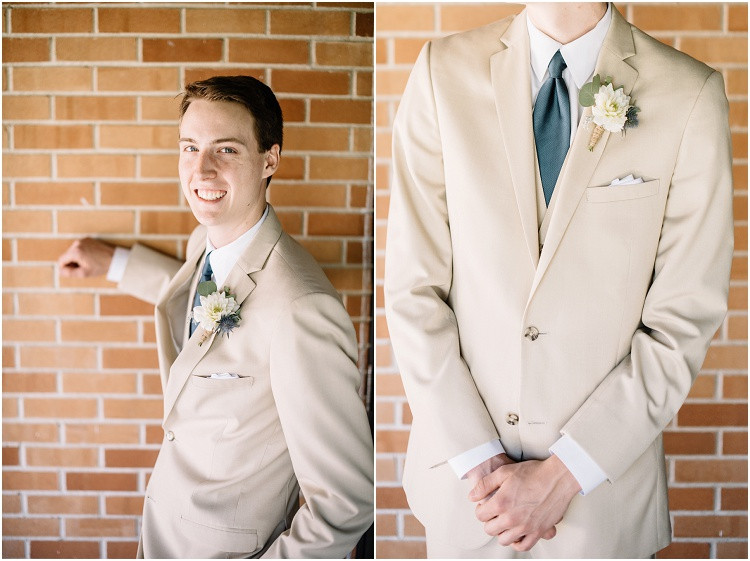 groom-leaning-against-wall-looking-at-camera-at-minnesota-wedding-by-appleton-wedding-photographer-kyra-rane-photography