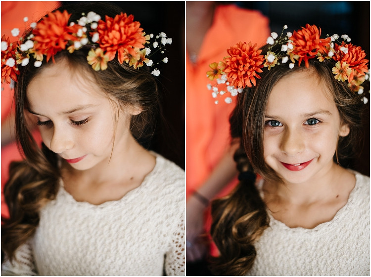 flower-girl-in-orange-wreath-at-barnsite-retreat-and-events-wedding-by-milwaukee-wedding-photographer-kyra-rane-photography