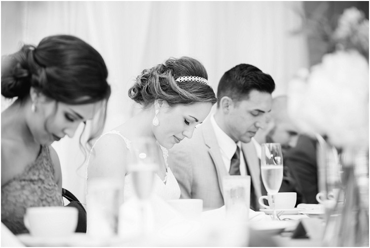 praying-at-dinner-at-best-western-premier-waterfront-hotel-wedding-by-green-bay-wedding-photographer-kyra-rane-photography